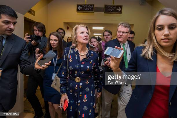 Sen Shelley Moore Capito RWVa talks with reporters in the senate subway before a series of votes in the Capitol related to the healthcare plan on...