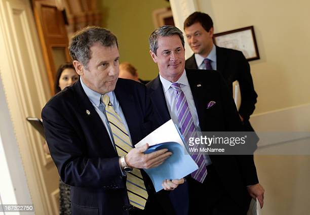 Sen Sherrod Brown and Sen David Vitter arrive for a press conference announcing the details of 'Too Big to Fail' legislation at the US Capitol April...