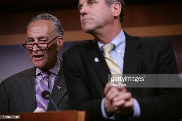 S Sen Sherrod Brown listens as Sen Charles Schumer speaks during a news conference May 12 2015 on Capitol Hill in Washington DC Senate Democrats...