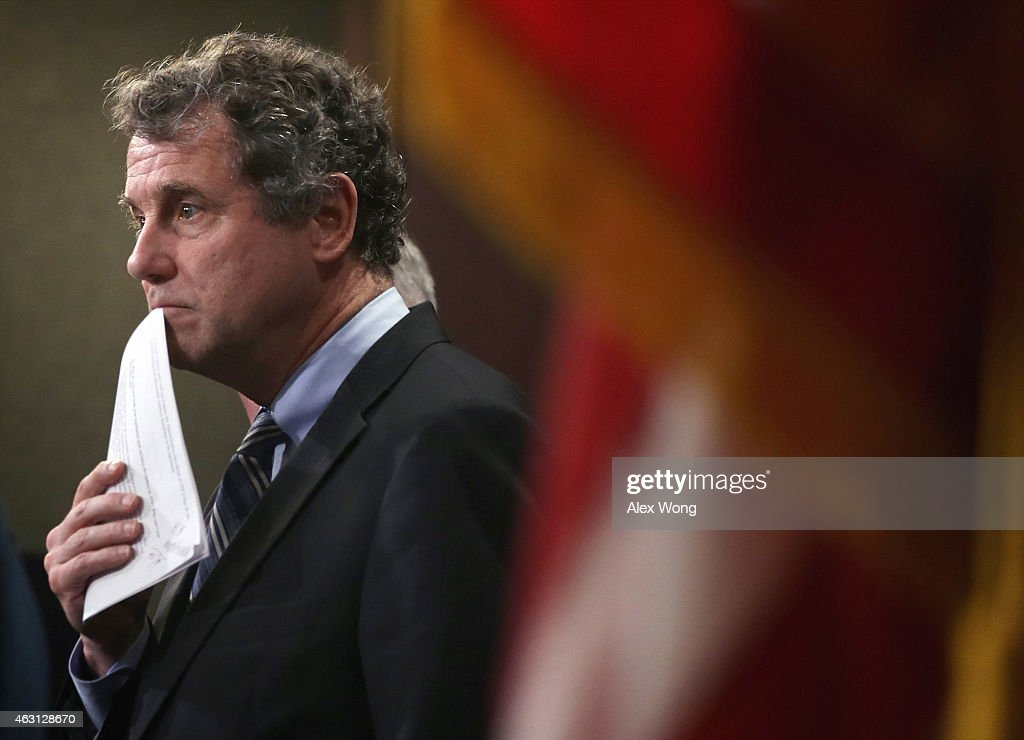 U.S. Sen. <a gi-track='captionPersonalityLinkClicked' href=/galleries/search?phrase=Sherrod+Brown&family=editorial&specificpeople=3986311 ng-click='$event.stopPropagation()'>Sherrod Brown</a> (D-OH) pauses during a news conference on currency and trade February 10, 2015 on Capitol Hill in Washington, DC. A group of bipartisan senators will introduce the Currency Exchange Rate Oversight Reform Act of 2015 to combat currency manipulation and create jobs at the same time.