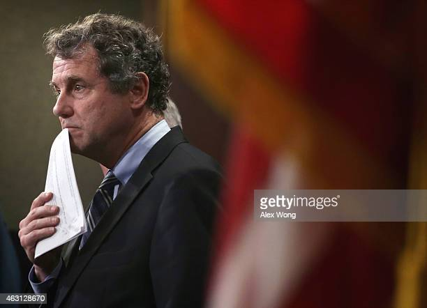 S Sen Sherrod Brown pauses during a news conference on currency and trade February 10 2015 on Capitol Hill in Washington DC A group of bipartisan...