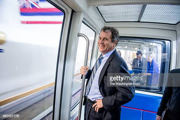 Sen Sherrod Brown rides a Senate subway to the US Capitol Building on Capitol Hill on January 27 2015 in Washington DC Also pictured is Sen Elizabeth...