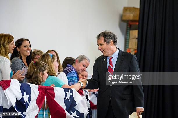 Sen Sherrod Brown shakes hands before speaking at a campaign rally for Democratic presidential candidate Hillary Clinton on June 13 2016 in Cleveland...