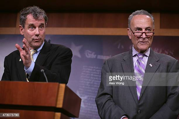 S Sen Sherrod Brown speaks as Sen Charles Schumer listens during a news conference May 12 2015 on Capitol Hill in Washington DC Senate Democrats...