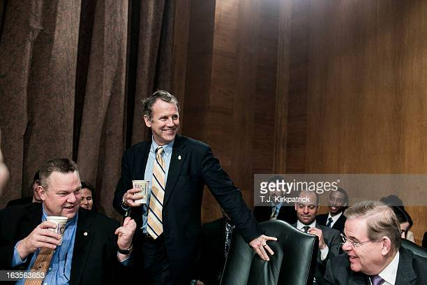 S Sen Sherrod Brown takes his seat beside Sen Jon Tester and US Sen Robert Menendez before the confirmation hearing of Richard Cordray nominee for...