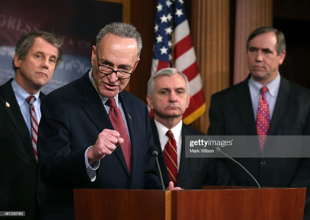 , U.S. Sen. <a gi-track='captionPersonalityLinkClicked' href=/galleries/search?phrase=Sherrod+Brown&family=editorial&specificpeople=3986311 ng-click='$event.stopPropagation()'>Sherrod Brown</a> (D-OH), U.S. Sen. Chuck Schumer (D-NY), U.S. Sen. <a gi-track='captionPersonalityLinkClicked' href=/galleries/search?phrase=Jack+Reed+-+Politician&family=editorial&specificpeople=534274 ng-click='$event.stopPropagation()'>Jack Reed</a> (D-RI) and U.S. Sen. Jeff Merkly (D-OR), speak to the media after the Senate voted on unemployment insurance at the U.S. Capitol January 7, 2014 in Washington, DC. The U.S. Senate voted 60-37 to move forward with a bill to extend federal unemployment benefits for three months.