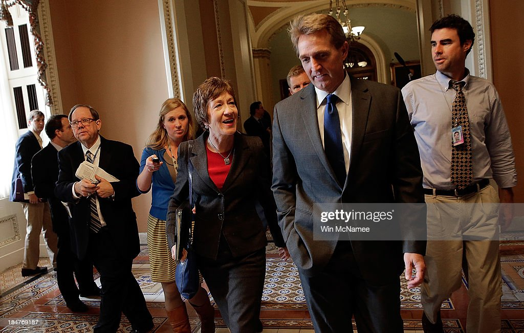 Sen. <a gi-track='captionPersonalityLinkClicked' href=/galleries/search?phrase=Susan+Collins&family=editorial&specificpeople=212962 ng-click='$event.stopPropagation()'>Susan Collins</a> (R-ME) and Sen. <a gi-track='captionPersonalityLinkClicked' href=/galleries/search?phrase=Jeff+Flake&family=editorial&specificpeople=2474871 ng-click='$event.stopPropagation()'>Jeff Flake</a> (R-AZ) arrive for a meeting of Senate Republicans on a solution for the pending budget and debt limit impasse at the U.S. Capitol October 16, 2013 in Washington, DC. The U.S. government shutdown is in its sixteenth day as the U.S. Senate and House of Representatives remain gridlocked on funding the federal government and the extending the nation's debt limit.