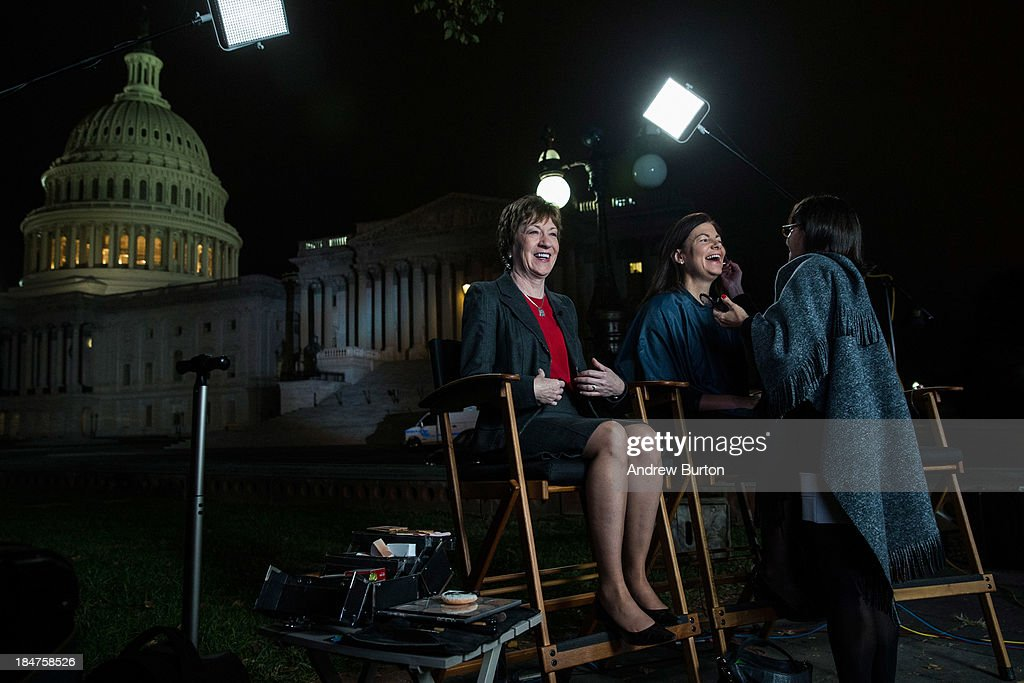 Sen. <a gi-track='captionPersonalityLinkClicked' href=/galleries/search?phrase=Susan+Collins&family=editorial&specificpeople=212962 ng-click='$event.stopPropagation()'>Susan Collins</a> (R-ME) and Sen. <a gi-track='captionPersonalityLinkClicked' href=/galleries/search?phrase=Kelly+Ayotte&family=editorial&specificpeople=6986995 ng-click='$event.stopPropagation()'>Kelly Ayotte</a> (R-NH) prepare to appear on national television together on the morning of October 16, 2013 in Washington, DC. Today marks the 16th day of the government shutdown and the last day to find a solution before the government could potentially begin defaulting on debts.
