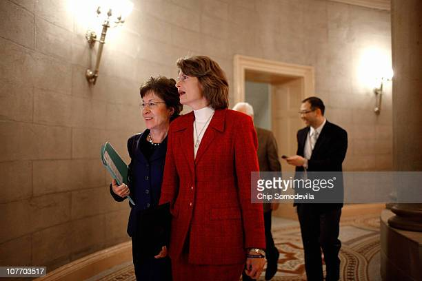 Sen Susan Collins and Sen Lisa Murkowski move between meetings before a closed session of the Senate about the New START Treaty a ratification of a...