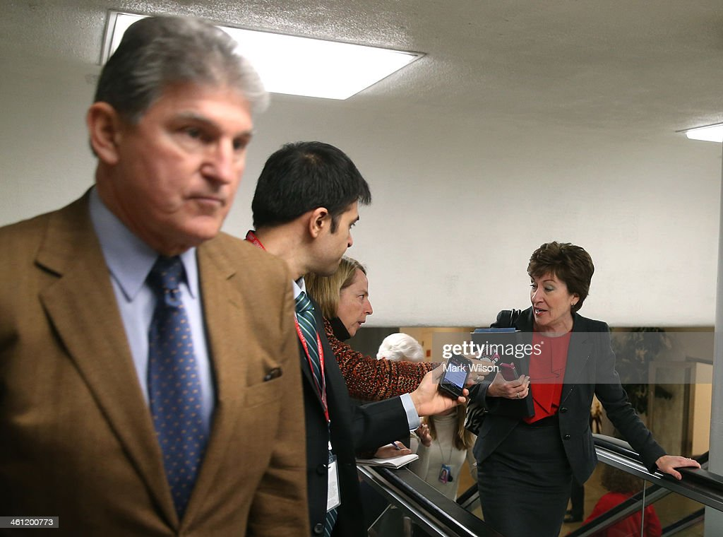 U.S. Sen. <a gi-track='captionPersonalityLinkClicked' href=/galleries/search?phrase=Susan+Collins&family=editorial&specificpeople=212962 ng-click='$event.stopPropagation()'>Susan Collins</a> (R-ME) (R) and U.S. Sen. <a gi-track='captionPersonalityLinkClicked' href=/galleries/search?phrase=Joe+Manchin&family=editorial&specificpeople=568465 ng-click='$event.stopPropagation()'>Joe Manchin</a> (D-WV) (L) head to the Senate chamber for the cloture vote on unemployment insurance at the U.S. Capitol January 7, 2014 in Washington, DC. The U.S. Senate voted 60-37 to move forward with a bill to extend federal unemployment benefits for three months.