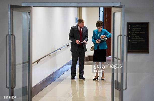Sen Susan Collins RMaine check her watch as she speaks with staff in the hallway leading form the Capitol to the CVC on Tuesday May 14 2013