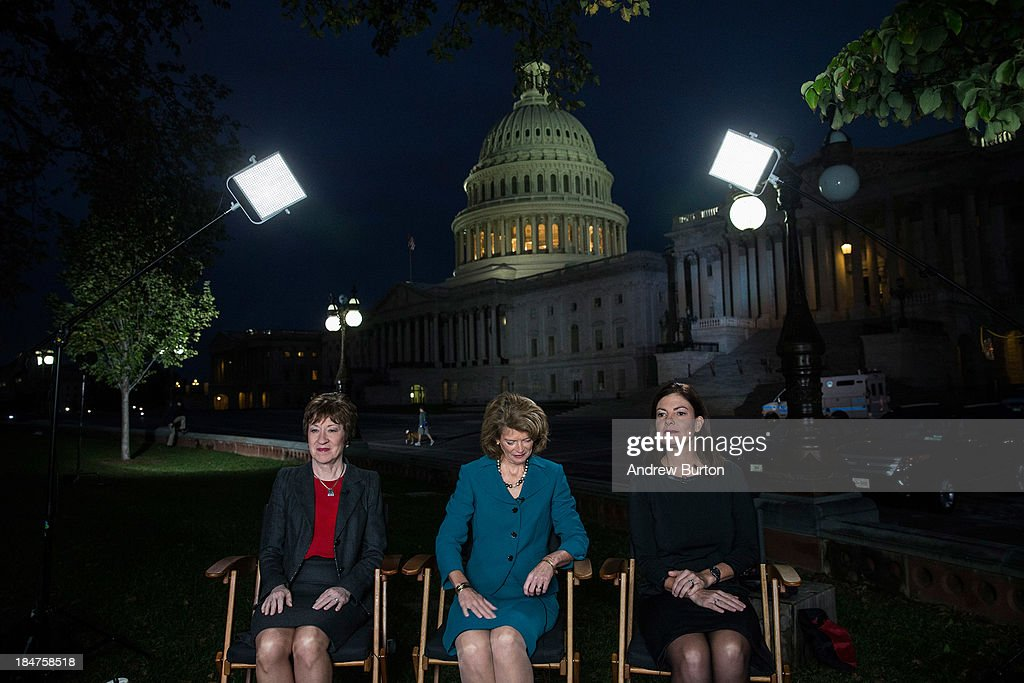 Sen. <a gi-track='captionPersonalityLinkClicked' href=/galleries/search?phrase=Susan+Collins+-+Politician&family=editorial&specificpeople=212962 ng-click='$event.stopPropagation()'>Susan Collins</a> (R-ME), Sen. <a gi-track='captionPersonalityLinkClicked' href=/galleries/search?phrase=Lisa+Murkowski&family=editorial&specificpeople=3134392 ng-click='$event.stopPropagation()'>Lisa Murkowski</a> (R-AK), and Sen. <a gi-track='captionPersonalityLinkClicked' href=/galleries/search?phrase=Kelly+Ayotte&family=editorial&specificpeople=6986995 ng-click='$event.stopPropagation()'>Kelly Ayotte</a> (R-NH) prepare to appear on national television on the morning of October 16, 2013 in Washington, DC. Today marks the 16th day of the government shutdown and the last day to find a solution before the government could potentially begin defaulting on debts.