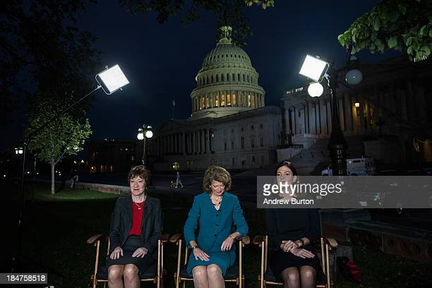 Sen Susan Collins Sen Lisa Murkowski and Sen Kelly Ayotte prepare to appear on national television on the morning of October 16 2013 in Washington DC...