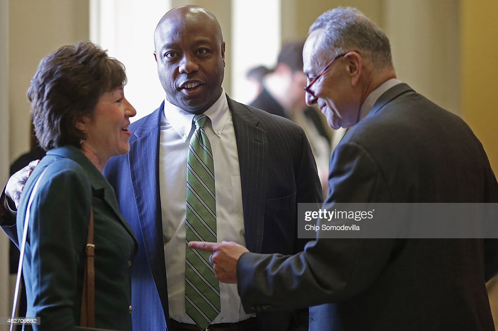 Sen. <a gi-track='captionPersonalityLinkClicked' href=/galleries/search?phrase=Susan+Collins&family=editorial&specificpeople=212962 ng-click='$event.stopPropagation()'>Susan Collins</a> (R-MD), Sen. <a gi-track='captionPersonalityLinkClicked' href=/galleries/search?phrase=Tim+Scott+-+Pol%C3%ADtico&family=editorial&specificpeople=12898323 ng-click='$event.stopPropagation()'>Tim Scott</a> (R-SC) and Sen. <a gi-track='captionPersonalityLinkClicked' href=/galleries/search?phrase=Charles+Schumer&family=editorial&specificpeople=171249 ng-click='$event.stopPropagation()'>Charles Schumer</a> (D-NY) visit before heading into their respective policy luncheons at the U.S. Capitol February 3, 2015 in Washington, DC. Congress is heading for a showdown with the White House as they threaten to cut off funding for the Homeland Security Department in reaction to President Barack Obama's immigration plan.