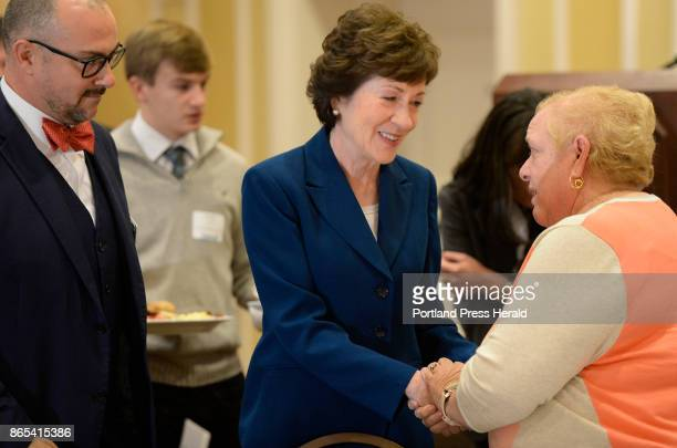 S Sen Susan Collins speaks with people at a Penobscot Bay Regional Chamber of Commerce event Friday where she announced she will not run for governor...