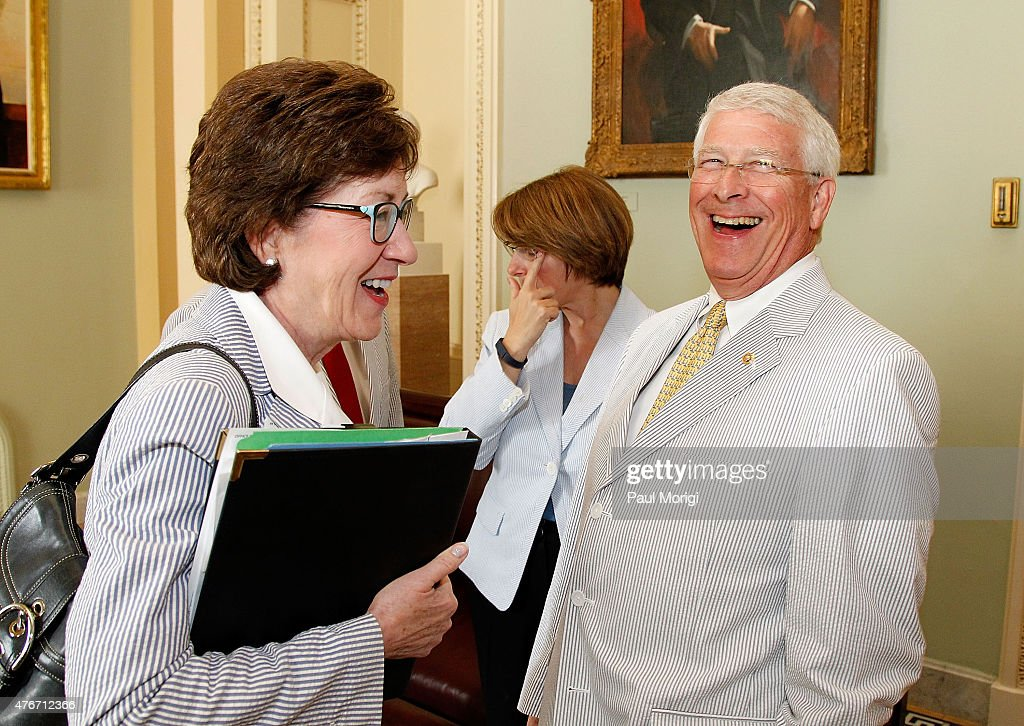 Sen. <a gi-track='captionPersonalityLinkClicked' href=/galleries/search?phrase=Susan+Collins&family=editorial&specificpeople=212962 ng-click='$event.stopPropagation()'>Susan Collins</a> (D-ME) talks with Sen. <a gi-track='captionPersonalityLinkClicked' href=/galleries/search?phrase=Roger+Wicker&family=editorial&specificpeople=1194753 ng-click='$event.stopPropagation()'>Roger Wicker</a> (R-MS) at a photo op gathering to celebrate National Seersucker Day at the U.S. Capitol Building on June 11, 2015 in Washington, DC.