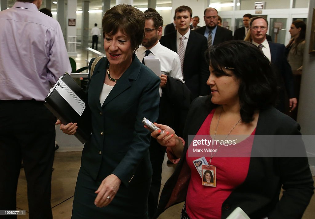 U.S. Sen. <a gi-track='captionPersonalityLinkClicked' href=/galleries/search?phrase=Susan+Collins&family=editorial&specificpeople=212962 ng-click='$event.stopPropagation()'>Susan Collins</a> (R-ME) (L) walkS to vote on the Senate floor April 17, 2013 on Capitol Hill in Washington, DC. The Senate rejected a proposal by Sens. Joe Manchin (D-WV) and Pat Toomey (R-PA) to expand background checks on firearms purchases and to close the so-called gun-show loophole.
