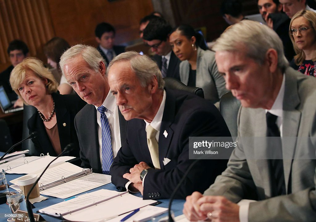 , Sen. Tammy Baldwin (D-WI), Chairman Ron Johnson (R-WI), Sen. Tom Carper (D-DE), and Sen. Rob Portman (R-OH), listen to statements during a Senate Homeland Security and Governmental Affairs Committee round table discussion on the Zika Virus, June 29, 2016 in Washington, DC. The committee hosted the discussion to learn how to prepare and protect the nation from the Zika Virus.