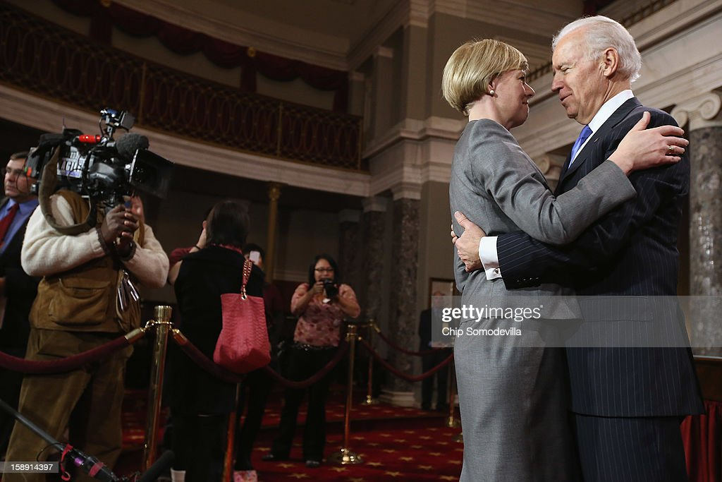 U.S. Sen. Tammy Baldwin (D-WI) (L) embraces U.S. Vice President Joe Biden before participating in a reenacted swearing-in in the Old Senate Chamber at the U.S. Capitol January 3, 2013 in Washington, DC. Biden swore in the newly-elected and re-elected senators earlier in the day on the floor of the current Senate chamber.