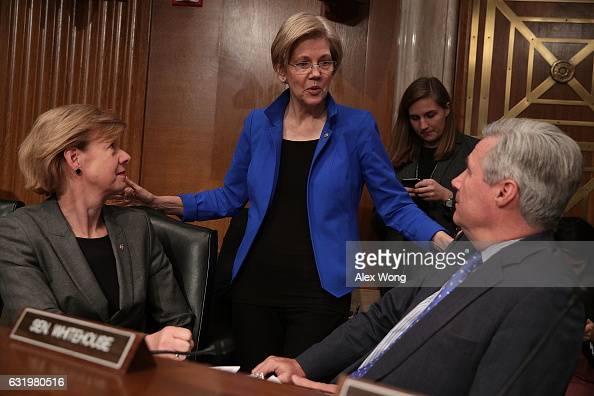 US Sen Tammy Baldwin Sen Elizabeth Warren and Sen Sheldon Whitehouse chat during a break of a confirmation hearing for Health and Human Services...