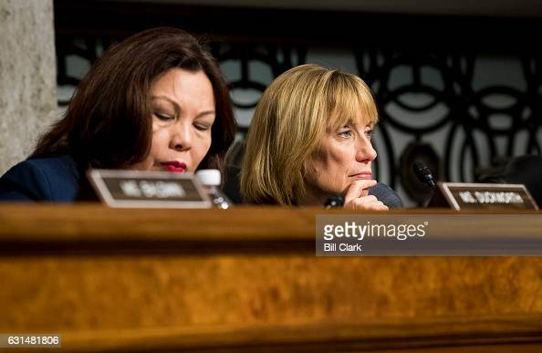 Sen Tammy Duckworth DIll left and Sen Maggie Hassan DNH listen during the confirmation hearing for Secretary of Transportation nominee Elaine Chao in...