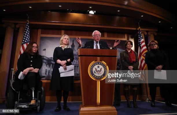 US Sen Tammy Duckworth Sen Kirsten Gillibrand Sen Bernie Sanders Sen Amy Globuchar and Sen Heidi Heitkamp attend a news conference at the US Capitol...