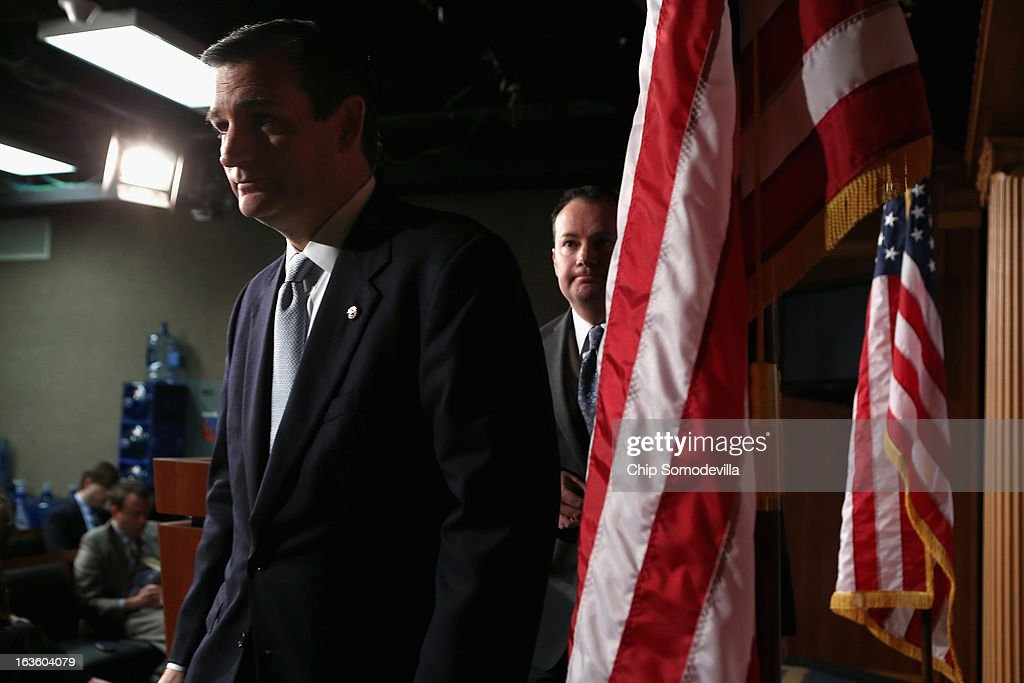 Sen. <a gi-track='captionPersonalityLinkClicked' href=/galleries/search?phrase=Ted+Cruz&family=editorial&specificpeople=7222093 ng-click='$event.stopPropagation()'>Ted Cruz</a> (R-TX) (L) and Sen. Mike Lee (R-UT) leave after holding a news conference to announce their plan to defund the Patient Protection and Affordable Care Act, also known as Obamacare, at the U.S. Capitol March 13, 2013 in Washington, DC. Although the conservative senators expect the legislation to fail, they believe it is an important survey of who supports health care reform.