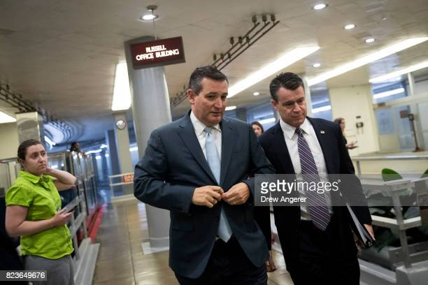 Sen Ted Cruz and Sen Todd Young walk through the Senate subway on his way to an amendment vote on the GOP heath care legislation on Capitol Hill July...