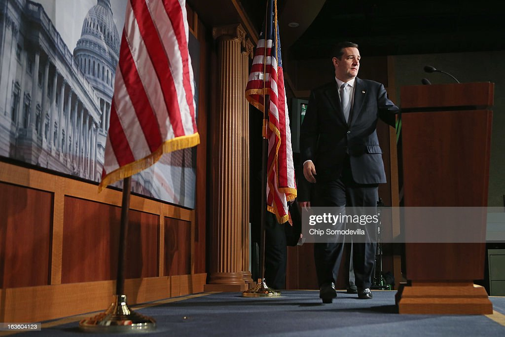 Sen. <a gi-track='captionPersonalityLinkClicked' href=/galleries/search?phrase=Ted+Cruz&family=editorial&specificpeople=7222093 ng-click='$event.stopPropagation()'>Ted Cruz</a> (R-TX) arrives for a news conference to announce a plan to defund the Patient Protection and Affordable Care Act, also known as Obamacare, at the U.S. Capitol March 13, 2013 in Washington, DC. Although Cruz and his fellow sponsors expect the legislation to fail, they believe it is an important survey of who supports health care reform.
