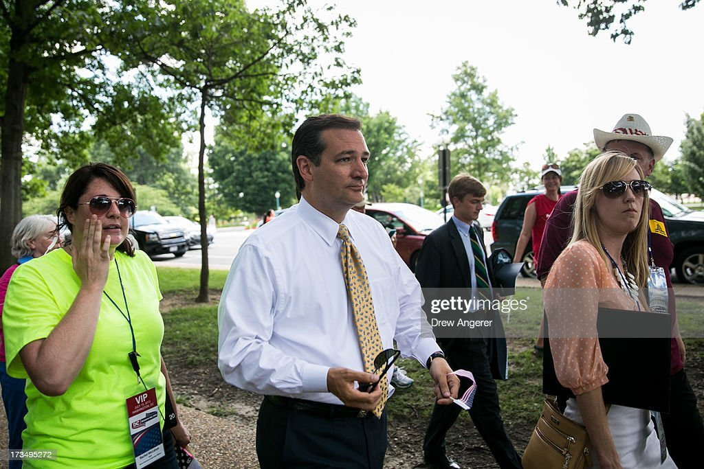Sen. <a gi-track='captionPersonalityLinkClicked' href=/galleries/search?phrase=Ted+Cruz&family=editorial&specificpeople=7222093 ng-click='$event.stopPropagation()'>Ted Cruz</a> (R-TX) arrives to speak about immigration during the DC March for Jobs in Upper Senate Park near Capitol Hill, on July 15, 2013 in Washington, DC. Conservative activists and supporters rallied against the Senate's immigration legislation and the impact illegal immigration has on reduced wages and employment opportunities for some Americans.