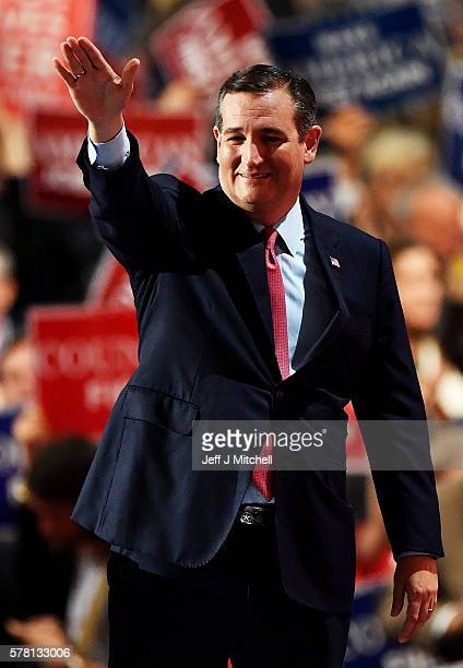 Sen Ted Cruz gestures as he walks on stage to deliver a speech on the third day of the Republican National Convention on July 20 2016 at the Quicken...