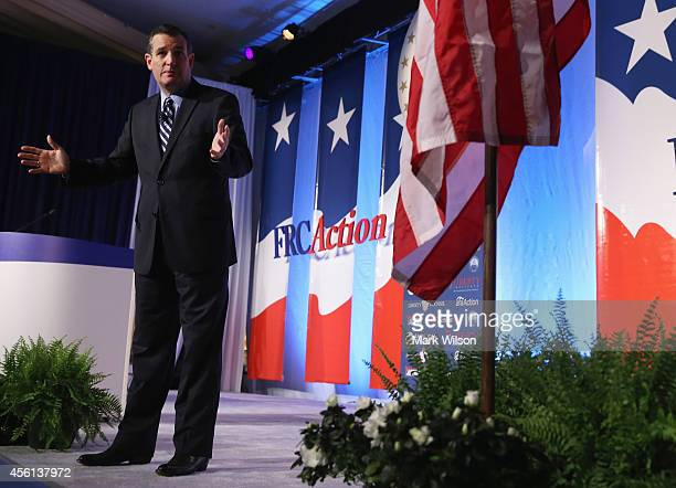 Sen Ted Cruz is applauded while speaking at the 2014 Values Voter Summit September 26 2014 in Washington DC The Family Research Council hosting its...