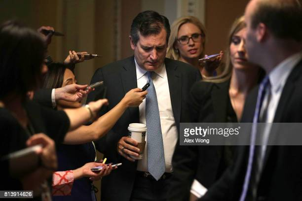 S Sen Ted Cruz is surround by members of the media as he is on his way to view the details of a new health care bill July 13 2017 at the Capitol in...