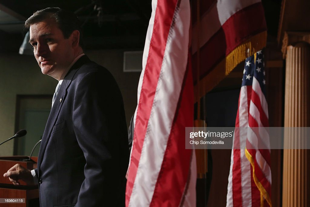 Sen. <a gi-track='captionPersonalityLinkClicked' href=/galleries/search?phrase=Ted+Cruz&family=editorial&specificpeople=7222093 ng-click='$event.stopPropagation()'>Ted Cruz</a> (R-TX) leaves after holding a news conference to announce their plan to defund the Patient Protection and Affordable Care Act, also known as Obamacare, at the U.S. Capitol March 13, 2013 in Washington, DC. Although the Cruz and his fellow sponsors expect the legislation to fail, they believe it is an important survey of who supports health care reform.