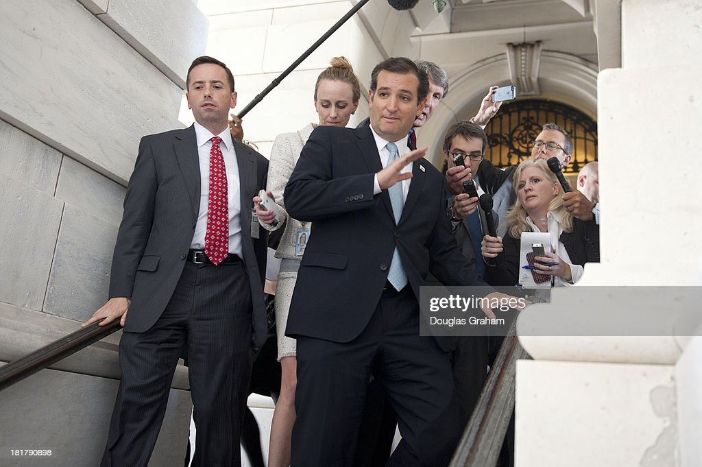 Sen. Ted Cruz (R-TX) leaves the Senate Chamber after his 21 plus hour speech that started on September 24, and ended on September 25, 2013. Sen. Cruz is leading the effort in the Senate to defund Obamacare.
