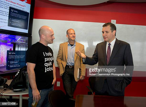 US Sen Ted Cruz of Texas r meets with Josh Baer and Brad Moore as he blasts an Obama plan to further regulate the Internet during a gathering at...