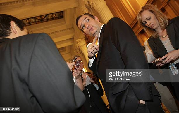 S Sen Ted Cruz points to the Senate chamber as he speaks with reporters after the US Senate voted to approve a $11 trillion omnibus funding bill...