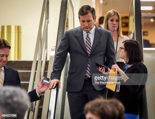 Sen Ted Cruz right talks with reporters as he makes his way to the Senate Intelligence Committee meeting to discuss the recent revelations from the...