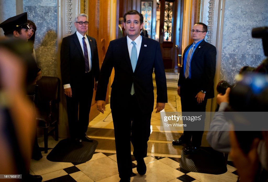 Sen. Ted Cruz, R-Texas, leaves the Senate floor of the Capitol after speaking for more than 21 hours against President Obama's health care law.
