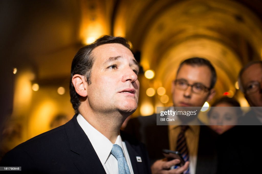 Sen. Ted Cruz, R-Texas, stops to speak to reporters as he leaves the Capitol following his 21 hour speech on the Senate floor opposing Obamacare on Wednesday, Sept. 25, 2013.