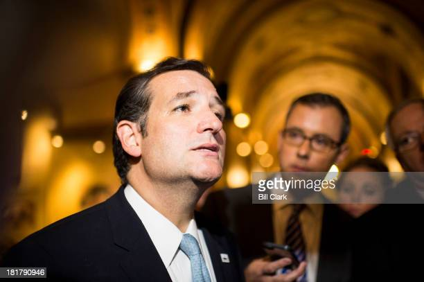 Sen Ted Cruz RTexas stops to speak to reporters as he leaves the Capitol following his 21 hour speech on the Senate floor opposing Obamacare on...