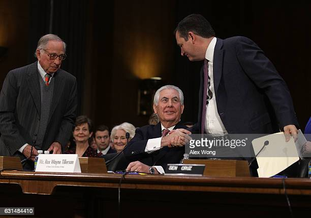 S Sen Ted Cruz shakes hands with former ExxonMobil CEO Rex Tillerson Presidentelect Donald TrumpÕs nominee for Secretary of State as former Sen Sam...