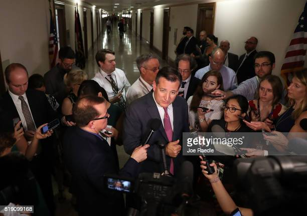 Sen Ted Cruz speaks to reporters after attending a healthcare bill meeting with fellow Republican senators at the Dirksen Senate Office Building on...