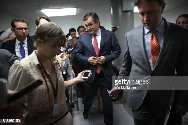 Sen Ted Cruz speaks with reporters while walking to a vote on the Senate floor at the US Capitol July 12 2017 in Washington DC Members of the Senate...