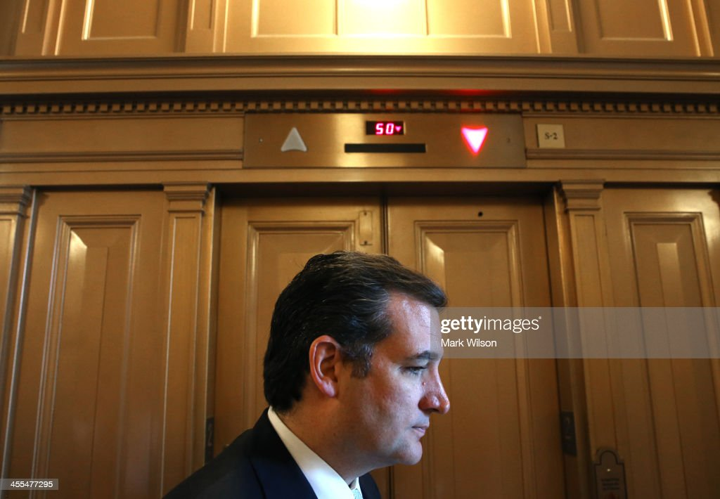 Sen. <a gi-track='captionPersonalityLinkClicked' href=/galleries/search?phrase=Ted+Cruz&family=editorial&specificpeople=7222093 ng-click='$event.stopPropagation()'>Ted Cruz</a> (R-TX) waits for an elevator off the Senate floor at the US Capitol, on December 12, 2013 in Washington, DC. The Senate worked through the night debating President Obama's Circuit Court nominations.