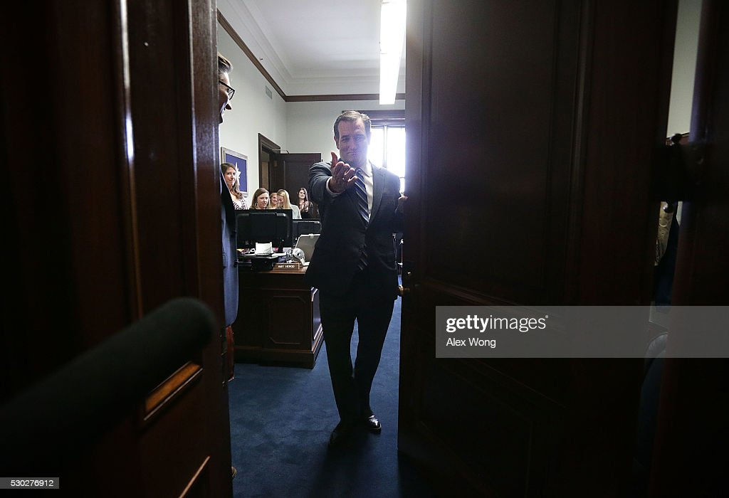 U.S. Sen. Ted Cruz (R-TX) waves to an unidentified person from his office at the Senate Russell Office Building after he spoke to members of the media May 10, 2016 on Capitol Hill in Washington, DC. Sen. Cruz returned to the Senate after he had dropped out of the U.S. presidential race.