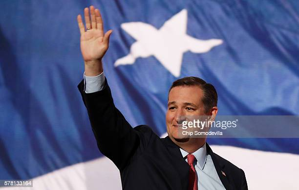 Sen Ted Cruz waves to the crowd as he walks on stage to deliver a speech on the third day of the Republican National Convention on July 20 2016 at...