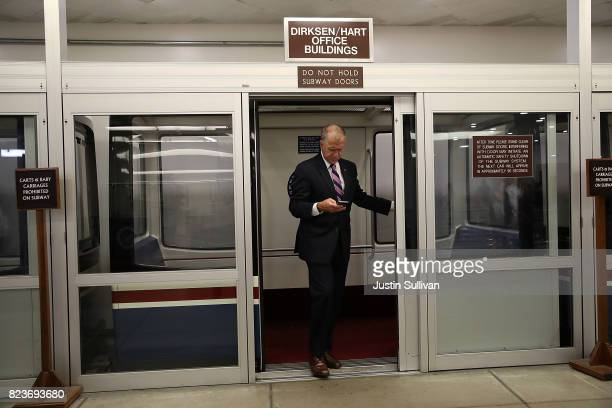 S Sen Thom Tillis steps off the Senate subway as he walks to the US Capitol before allnight voting July 27 2017 in Washington DC Senate Republicans...