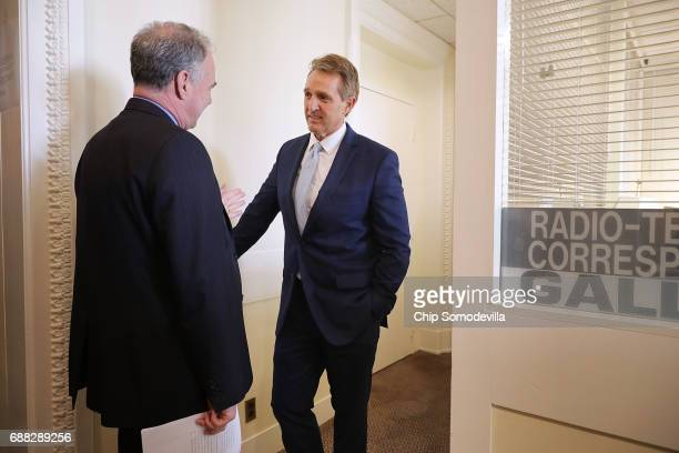 Sen Tim Kaine and Sen Jeff Flake prepare for a news conference where they will talk about a new Authorization for the Use of Military Force against...