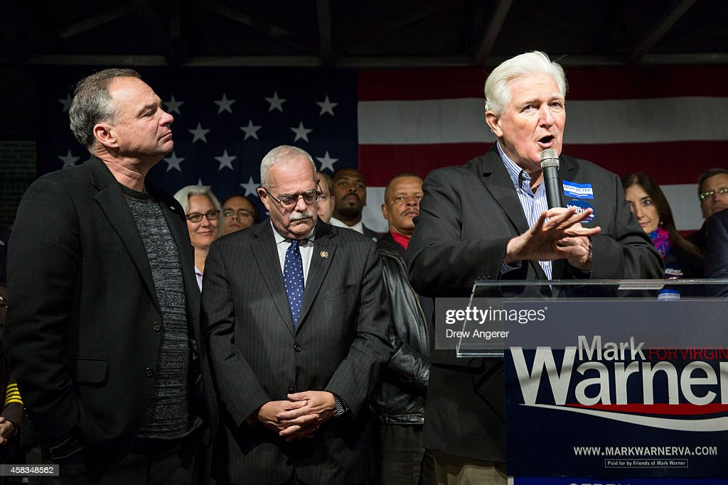 U.S. Sen. Tim Kaine (D-VA) and U.S. Rep. Gerry Connolly (D-VA) look on as U.S. Rep. Jim Moran (D-VA) speaks during a Get Out the Vote rally for Democratic candidates, November 3, 2014 in Alexandria, Virginia. Voters go to the polls tomorrow, November 4th, to decide a number of tight races.